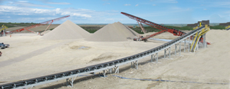 over land conveyors, aggregate stockpile, radial stackers, conveyor vs haul truck